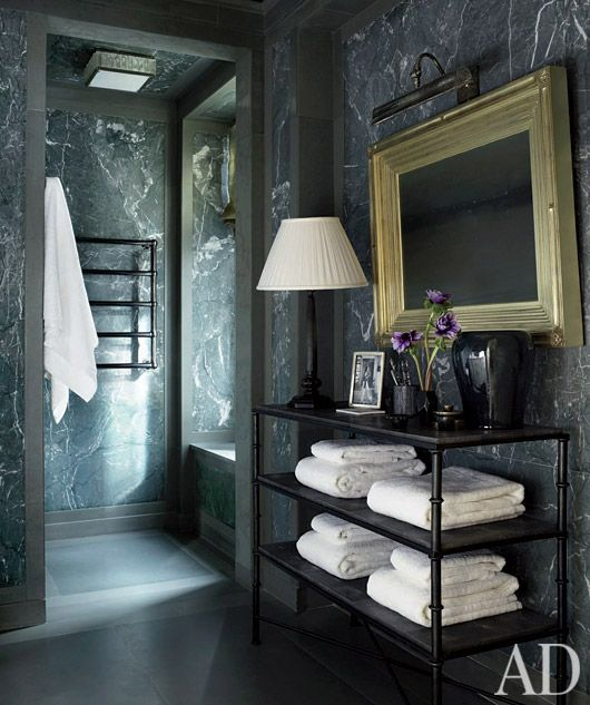 Masculine Bath for the bachelor who wants a more dramatic & exotic setting beautiful marble walls & a warming rack for the towels....so cool!
