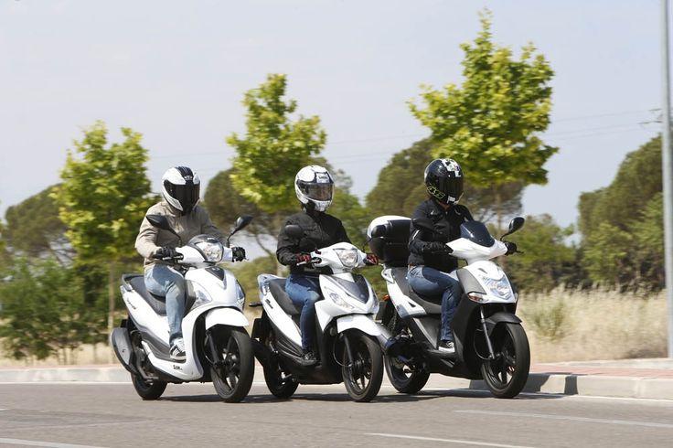 Comparativa Scooter: KYMCO Agility City 125, Suzuki Address 110 y SYM Symphony ST 125 | Motociclismo.es