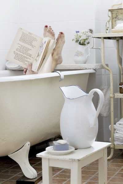 white pitcher and bathroom decor lucky gal I want those bear claw bath tubs I found someone who sells them here!