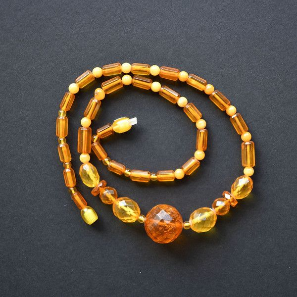 Vintage bead necklace of facetted transparent and mate amber Amber... ❤ liked on Polyvore featuring jewelry and necklaces