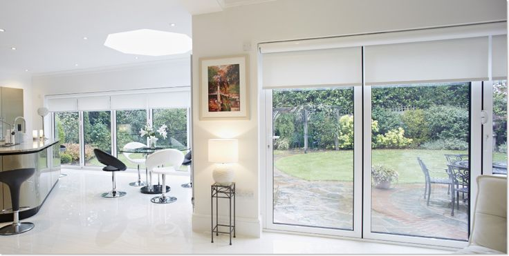 A kitchen/diner with bifold doors ideas.  Do love the blinds too.