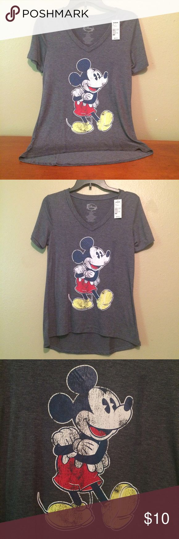 Mickey Mouse Distressed Vintage look Tshirt This super cute gray Mickey Mouse shirt has a distressed vintage look but is NWT. It is incredibly soft!! Size: XS Material: 62 % cotton 35% rayon 3% spandex. Length: 24 inches Bust.: 28 inches. Him: 36 inches. NWT Retail: $24 Tags: Mickey Mouse shirt. Mickey Mouse T-shirt. Disney sure. Vintage Mickey Mouse shirt. Distressed Mickey Mouse shirt. extra small Mickey Mouse shirt. Disney Tops Tees - Short Sleeve