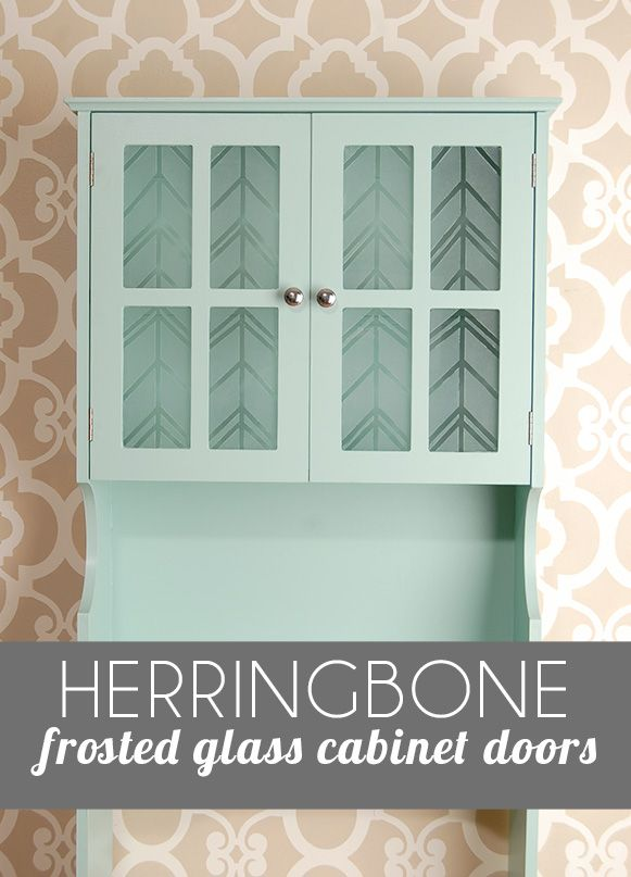 The ugly bathroom cabinet part 2-frosting the glass doors. Use skinny masking tape and frost paint to make a chic herringbone pattern, and hide all the girl goo!