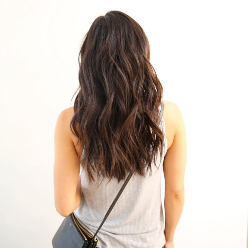 Hair - Falling below shoulder blades, brunette, smooth on top, below crown long waves, textured on ends.