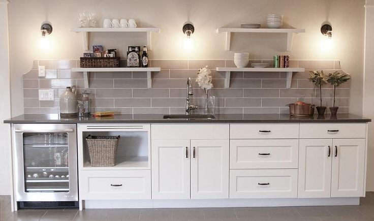 White And Gray Basement Wet Bar Features White Cabinets