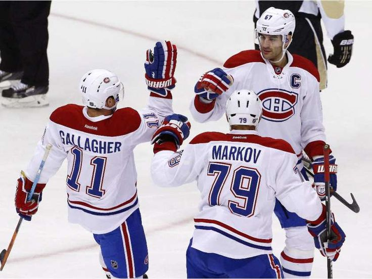 Montreal Canadiens' Max Pacioretty (67) celebrates his goal with teammates Brendan Gallagher (11), and Andrei Markov (79) in the first period of an NHL hockey game against the Pittsburgh Penguins in Pittsburgh Tuesday, Oct. 13, 2015.