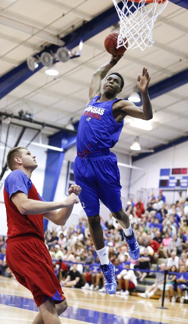 Blue Team forward Andrew Wiggins gets airborne for a dunk against Red Team center Cole Aldrich during a scrimmage before the basketball campers on Wednesday, June, 19, 2013 at the Horejsi Center.