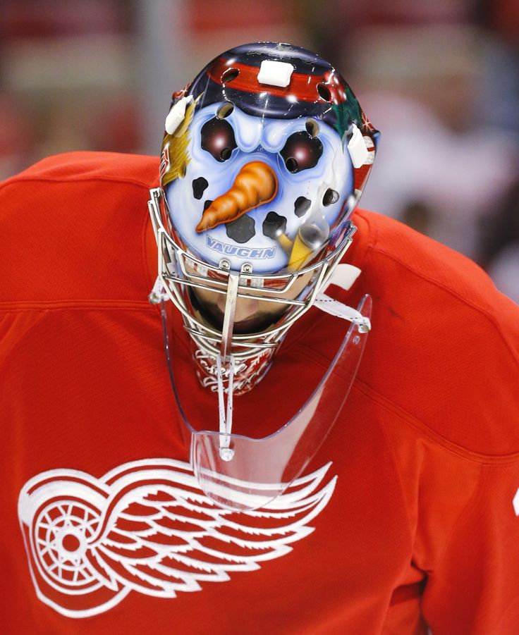 Detroit Red Wings goalie Petr Mrazek wears a snow man painted on his helmet. #hockey AP Photo/Paul Sancya - Curated by your friends at  https://createamixer.com/