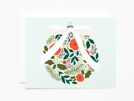 Deck the halls with these hand illustrated holiday cards featuring a floral ornament against a bright mint background. Each card is printed