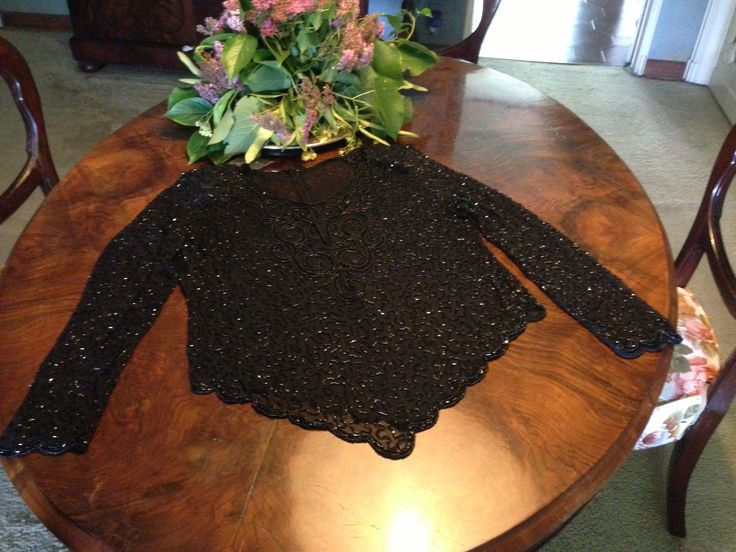 Luxurious evening black long sleeve blouse in chiffon, beads and rhinestones with an extremely sophisticated scallop fringe