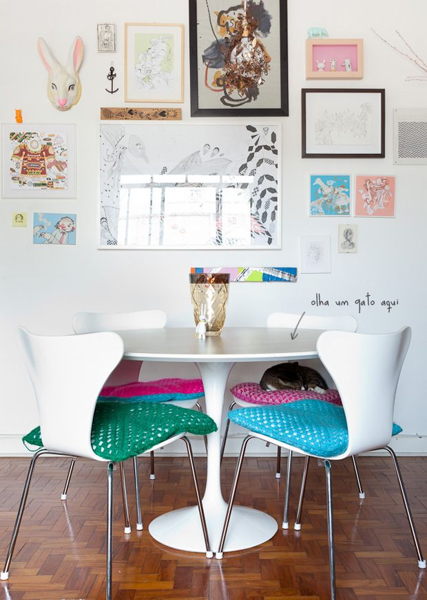 eclectic - I love how the very standard table and chairs (seriously, you can get that table at IKEA) are more lively with the bright multicoloured cushions, and the images in the gallery wall pick up the pinks, blues and white.