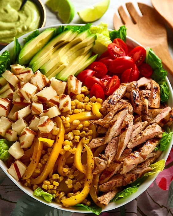 Grilled Tequila Lime Chicken Salad is a great way to celebrate National Tequila Day. This bright summer salad has the delicious flavor of V&V Supremo paired with the powerful kick of real Tequila! #LoveMyQueso