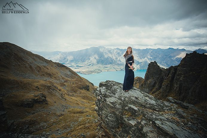 Bride stands about lake Wakatipu wedding photography queenstown