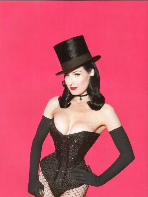 Dita Von Teese wearing a Top Hat & corset
