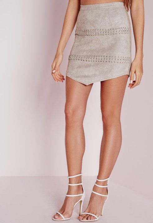 """Channel your inner cowgirl in this super soft faux leather mini skirt. With back zip fastening and lace up detail, wear with the matching crop top and thigh highs, yee-hah!  Approx length 43cm/17"""" (Based on a UK size 8 sample)  90% Polyes..."""