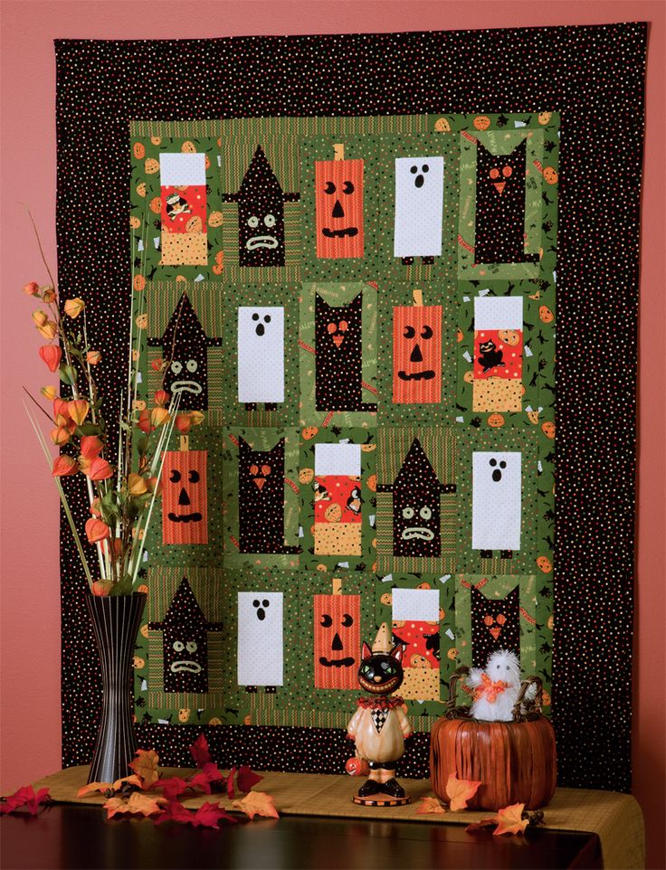 "Got scraps or fat quarters of Halloween fabrics? This boxy ""Boo!"" quilt is the perfect place for them to hang out every October."
