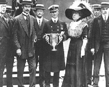Passenger Molly Brown presents crew of Carpathia with a silver cup for their rescue