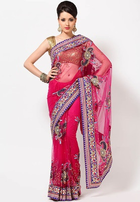 Margenta coloured, embroidered saree from Entropy Sarees. Made from net, it measures 5.5m and comes with a blouse piece measuring 0.8 m. Heavily embroidered, this beautiful saree from Entropy Sarees will surely make you stand out in the crowd. Crafted from net, it is light in weight and a perfcet pick for special occasions.