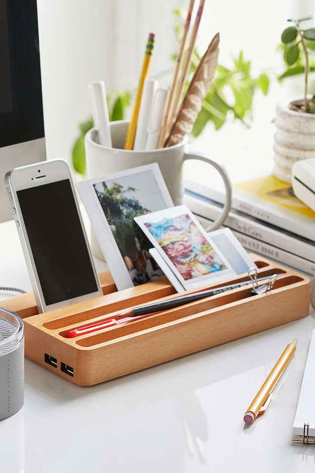 This wooden charging station with two USB ports to keep your devices in one place ($50).