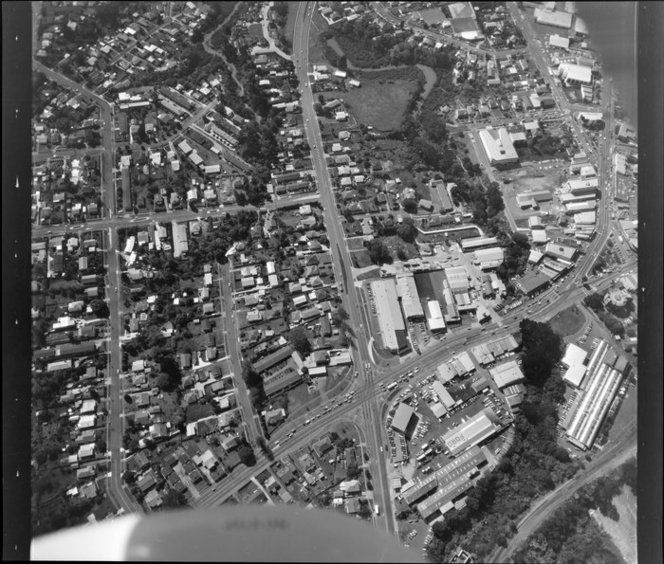 1988. Great North Rd and Titirangi Rd (bottom), New Lynn, West Auckland, NZ. Cambridge Clothing Co. and railway line bottom right.