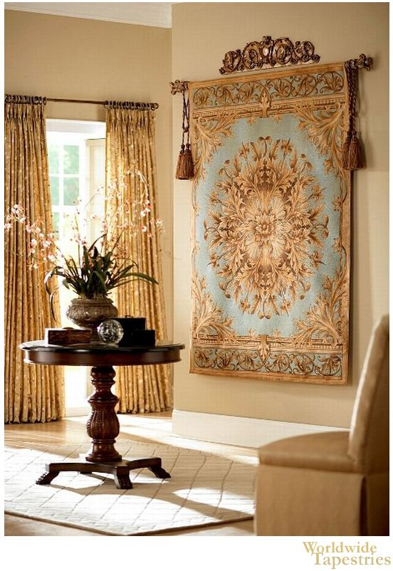 """This lovely tapestry """"Grand Baroque Aqua"""" shows a floral and foliage motif design in beige, earth tones and aqua blue. Full of beauty, this piece shows the decorative designs inspired by a combination of French florals and verdures, and Oriental and Persian art."""