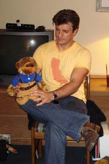 Nathan Fillion with a Capt. Mal teddy bear.