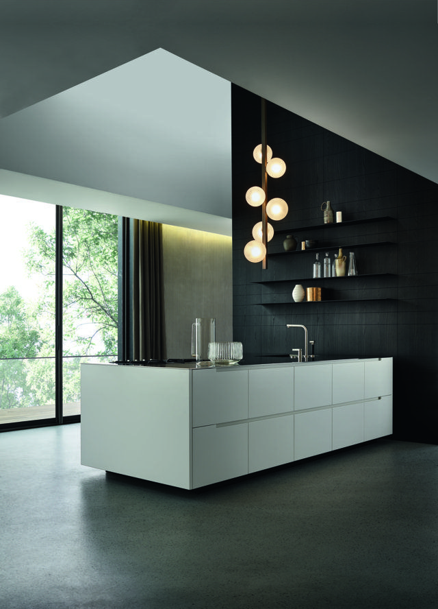 """Varenna_PHOENIX_kitchen with glacier white embossed lacquered base units, personalised steel worktop Varenna by Barazza thickness 1/4"""". Steel tall units with retractable doors. Wall panels in black elm with steel shelves thickness 1/8"""" in carbone embossed lacquered finishing"""