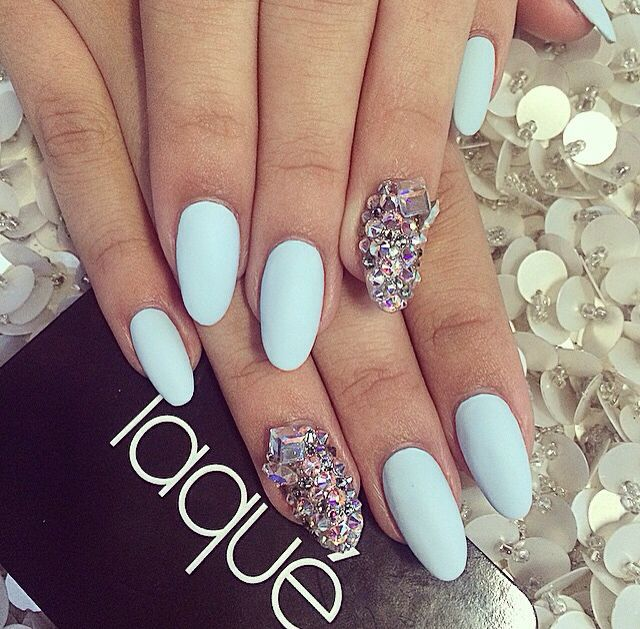 Blue Mat Nail Polish With Diamonds On The Ring Finger