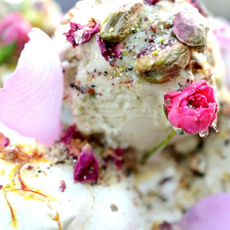 Saffron meringues with pistachio ice cream dressed with rose syrup and a sweet Dukkah.