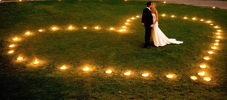 Heart shaped lights on the lawn to kiss in. Actually this is something we CAN recreate without too much expense! (Wedding garb not included! hahahaha!)