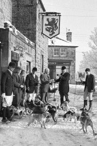 Landlord of Newbrough's Red Lion, George Wright, offers master of the Newcastle and District Beagles, Col. Leonard Gibson, a celebratory drink prior to the pack setting off. (Edition: January 21, 1977)
