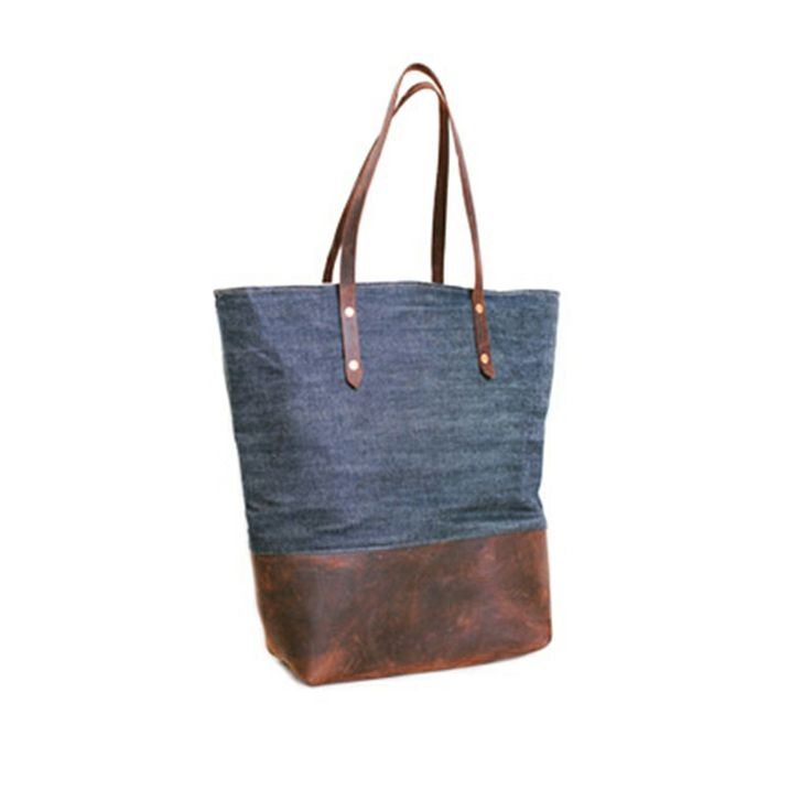 Made from raw denim selvedge that ages as amicably as your jeans, the Mills Bag is Boutonné's signature chambray-lined tote - the one that stoked the fire and got San Diego talking. Its copper rivets are shiny and its aroma of oiled leather begs for golden autumn afternoon adventures.  Sturdy and classic, this is a forever bag: one you'll come to believe your mother gave you, but that you won't want to give to your children.  http://sorrythanksiloveyou.com/products/view/mills-bag-boutonne