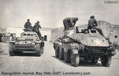 [Captured German Panzer II tank and 8-wheeled armored car]