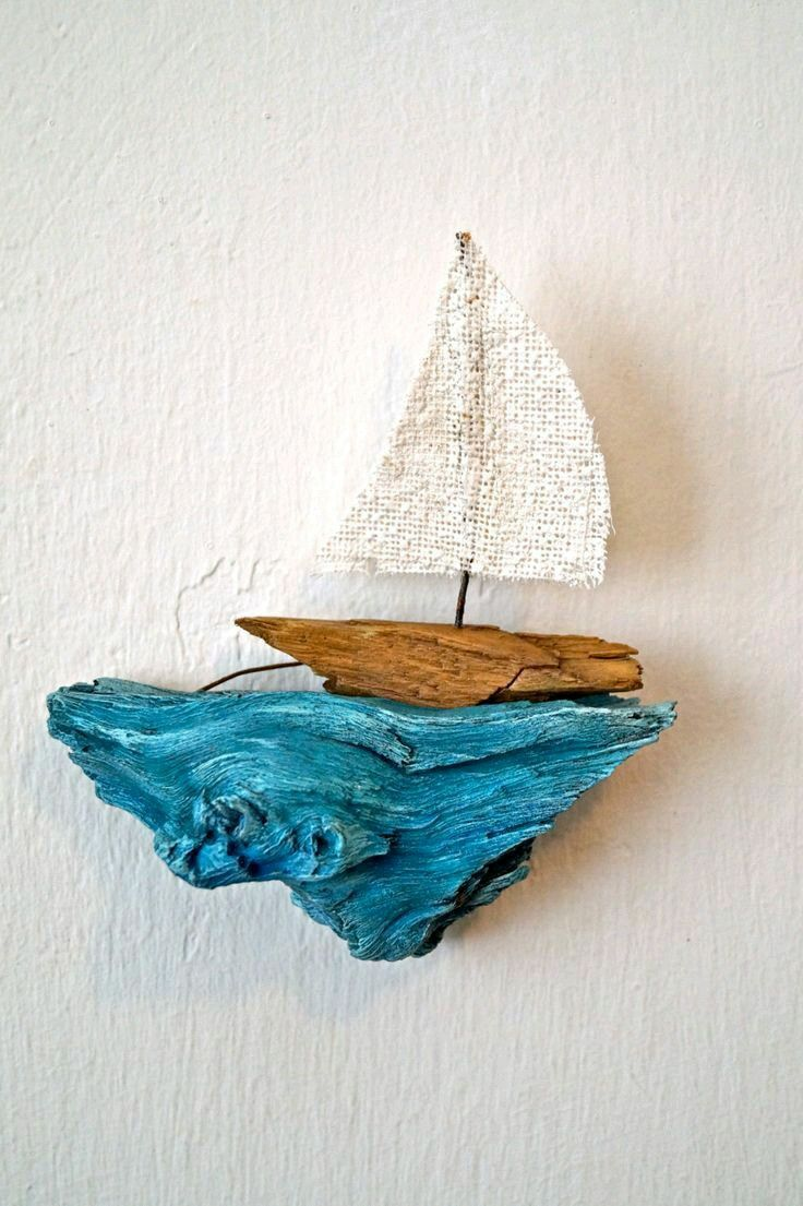 Looks like a beautiful driftwood wall art sailboat piece. Kids room anyone?