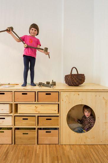 Reminds me of Ikea TROFAST - plywood front with big circle cutout=IKEA hack Kita Drachenhöhle - nach dem Umbau