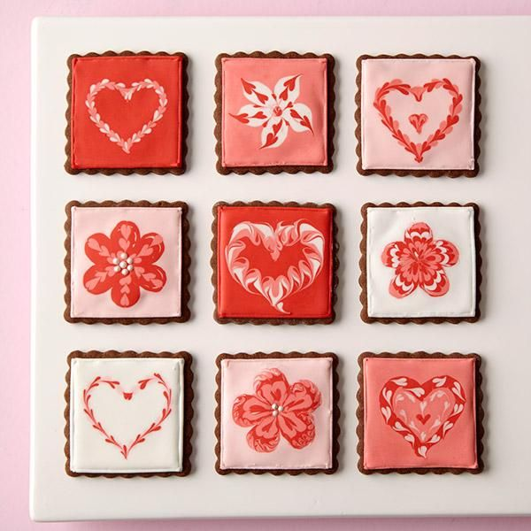 Love Squared Valentine Cookies - Create a soft, lacy icing effect on square-shaped roll-out cookies using the Color Flow dragging technique. These Valentine cookie ideas are great to give to friends, especially when presented in a Wilton Treat Box or Party Bags.