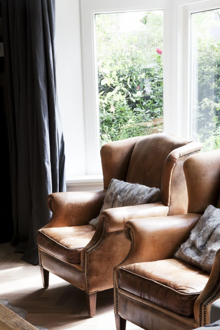 Cozy, warm, traditional camel color leather chair. Pair with streamlined furnishings.