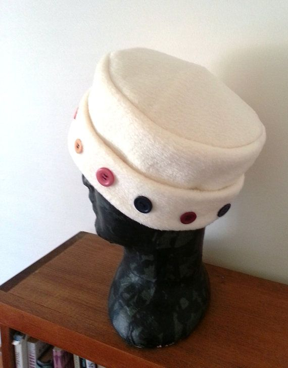 Fleece hat , women's off white button hat