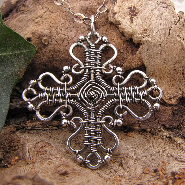 God's eye cross necklace~handmade wire wrapped sterling silver cross pendant with chain    This cross is entirely sterling silver with sterling silver beads and measures 1 3/8 inches square. The god's eye itself is 5/16.  God's eyes traditionally represent the four elements; earth, air, fire and water
