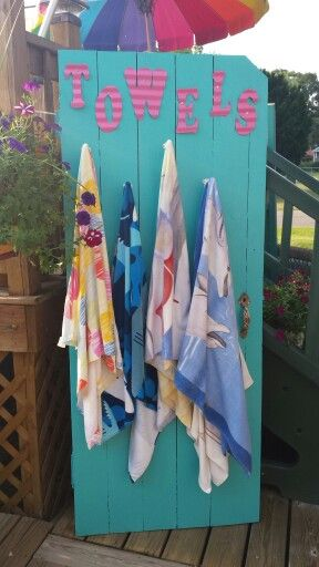 Old doorthat I turned into a pool towel holder!! I'd change it up, but I like the idea.