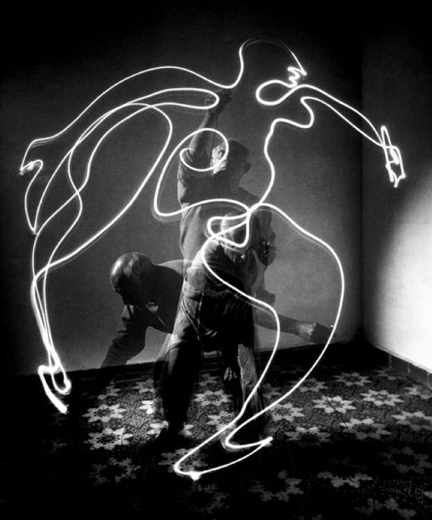 "Pablo Picasso using a small flashlight to ""draw"" a figure in the air in 1949."