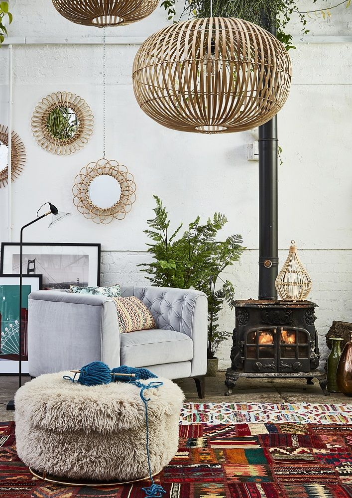 Embrace unique style with the Eclectibles trend. Combining Scandi style with bold Bohemian influences, this look will add a quirky appeal to your home. Get the look with the Renato grey fabric armchair which features a contemporary shape and chic button back detailing.