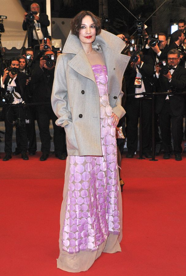"Cannes 2012: Jeanne Balibar at the premiere of ""Holy Motors,"" unfortunately she wore an over-sized coat covering such a beautiful gown."