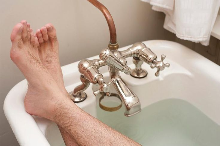 stretching out in a nice hot retro styled bath - free stock photo from www.freeimages.co.uk