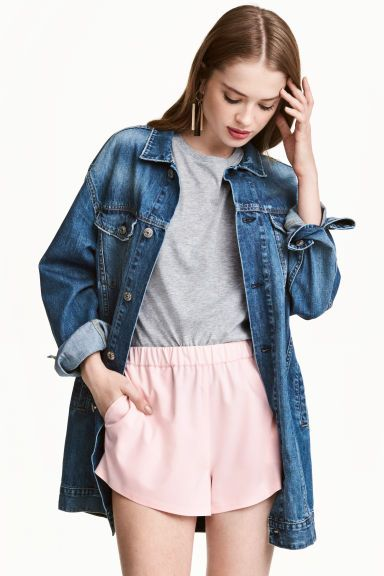 Long denim jacket: Long jacket in washed denim with a collar, buttons down the front and 3/4-length sleeves with buttoned cuffs. Flap chest pockets with a button, side pockets and an adjustable tab and button at the sides of the hem.