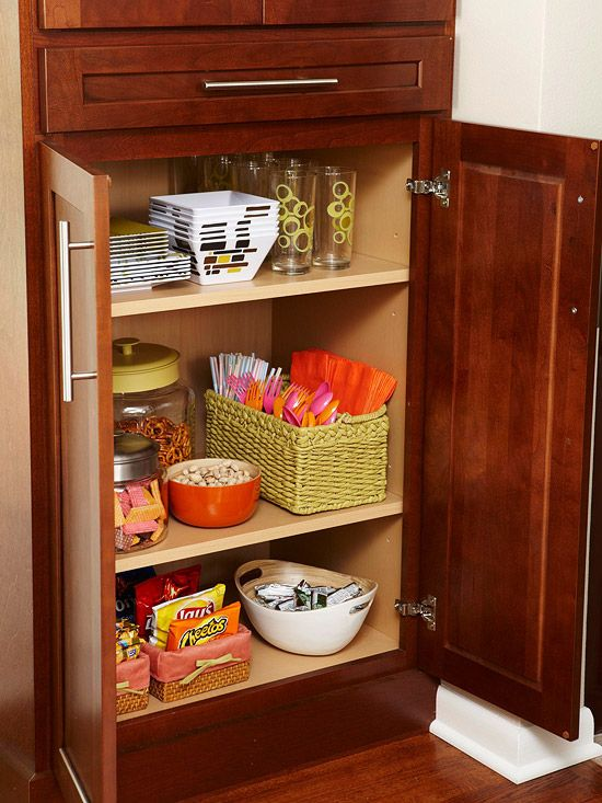 Give kids a cabinet of their own with dishes, snacks, etc., so they can be independent and helpful in the kitchen.