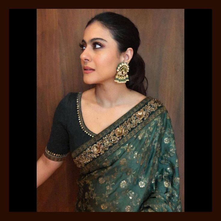 Kajol in a heritage Sabyasachi saree and peacock studs from the Sabyasachi Jewelry collection. Made in 22k gold uncut diamonds Zambian emeralds and heritage enamelling. <br> Styled by: Mohit Rai and Chandan. <br> For all jewellery related queries kindly contact sabyasachijewelry@sabyasachi.com.