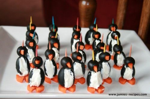 Jumbo pitted olives, small pitted olives, soften cream cheese,whole carrots, toothpicks. Thats all you need for these cute little penguin appetisers