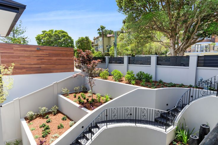The owner of this Art Deco style home was looking for a retaining solution that would integrate seemlessly with the look of his property. The result is nothing short of spectacular!