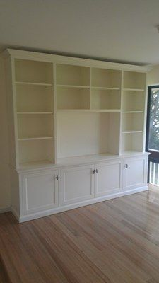 Custom TV Entertainment Wall Unit - this might require replacing current cabinets with lower ones (maybe stock kitchen ones for over fridge/etc)